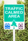 Traffic Sign Stating TRAFFIC CALMED AREA with pictures of houses Stock Image