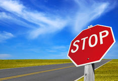Traffic sign stop. Close to road Royalty Free Stock Photo