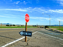 Traffic sign stop and one way at the street Stock Image