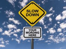"""Slow down. A traffic sign with the text """"Slow down"""" with a plaque with text placeholder Stock Photo"""