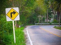 Traffic sign turn right on the road. The traffic sign for turn right on the road Stock Photos