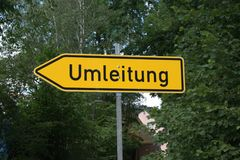 "Traffic sign `Umleitung` German for Detour. A metal traffic sign marked ""Umleitung"" German for Detour. Sign has a yellow reflective backing with a  black Stock Photo"