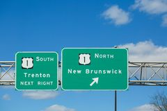 Traffic sign - US Route 1, south to Trenton, north to New Brunswick. Princeton New Jersey - March 16, 2019:Traffic sign - US Route 1, south to Trenton, north to stock photo