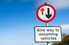 Traffic Sign Warning Drivers that They Have to Give Way to Vehicles from Opposite Direction Royalty Free Stock Images