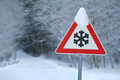 Traffic sign warns of snow Royalty Free Stock Image