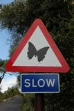 Traffic Sign. A traffic sign warns to go slow for Butterflies in Gibraltar, UK Stock Photos