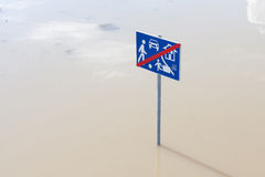 Traffic sign in water Stock Photography