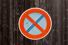 Traffic sign on a wooden background Royalty Free Stock Image