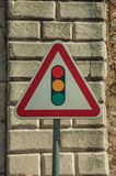 Traffic signal ahead road sign in front of stone brick wall. Close-up of TRAFFIC SIGNAL AHEAD road sign in front of stone brick wall, in a sunny day at Elvas. A royalty free stock photo