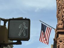 Traffic signal  and american flag Stock Photo