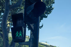 Traffic signal depicting people holding hands in Madrid, Spain, Stock Images