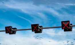Traffic signal light with red color of cross sign on blue sky and white clouds background. Wrong sign. No entry traffic sign. Red. Cross guidance stop go royalty free stock photos