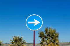 Traffic signal. Traffic sign indicating the obligation to go to the direction of the arrow indicated vehicles Royalty Free Stock Photos