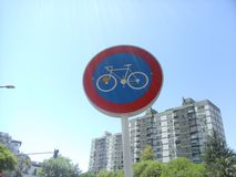 Traffic signal of single bicycles under the sun`s rays stock images