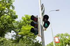 Traffic signal and street light against clear sky, Prague, Czech Republic Royalty Free Stock Photo