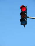Traffic signalization. Traffic lights on blue background Royalty Free Stock Images