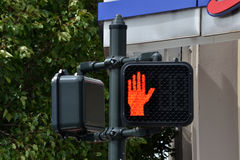 Traffic Signals-Hand indicating Stop. Traffic Signals, Electric Pedestrian Hand Signal indicating Stop or Halt Royalty Free Stock Image