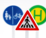 Traffic signs. Illustrated traffic signs with a pedestrian crosswalk caution sign in the foreground stock photography