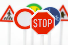 Traffic signs. Variety of colorful traffic signs with a red stop sign in the foreground Royalty Free Stock Image