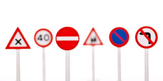 Traffic signs. Collection of traffic signs in a row, isolated on white background with shallow DoF Royalty Free Stock Photo