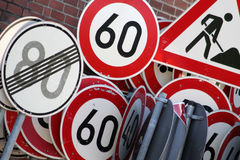 Traffic signs. Any traffic signs in front of the wall Stock Image