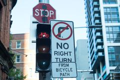 Traffic signs of bicycle path, stop, no right turn and red light royalty free stock images