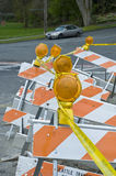 Traffic signs with constrction tape Stock Photo