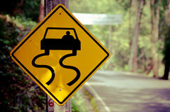 Traffic signs beside country road Stock Images
