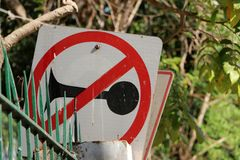 Traffic signs do not use sound on the fence beside the road royalty free stock image