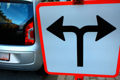 Traffic Signs in front of crossroad, Direction turn left or turn Royalty Free Stock Image