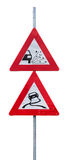 Traffic signs for loose chippings and slippery road. Against white background stock photos