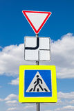 Traffic signs main road and pedestrian crossing Stock Photos