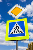 Traffic signs main road and pedestrian crossing Royalty Free Stock Image