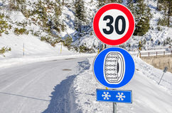 Traffic Signs on a Mountain Road Stock Photography