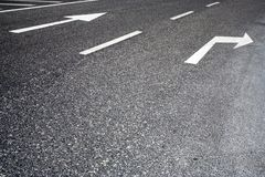 Traffic signs painted in road. Traffic signs painted in asphalt tarmac road Stock Images