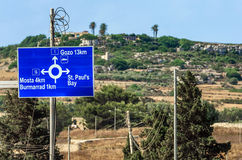Traffic sign - Malta. Road sign showing the way to some popular destinations - Bugibba, Malta Stock Photos