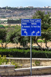 Traffic signs. Road sign showing the way to some popular destinations - Bugibba, Malta Stock Image
