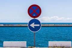 Traffic signs and the sea Royalty Free Stock Photo