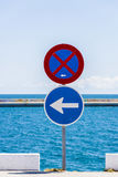 Traffic signs and the sea Royalty Free Stock Photos