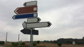 Traffic signs. Showing in different directions, lot of ways, variability of choice, crossroads royalty free stock photo