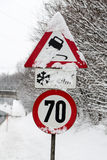Traffic signs and snow Royalty Free Stock Photos