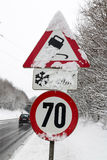 Traffic signs and snow. Symbol photo for winter weather, accident risk and speed limit stock photos