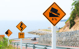 Traffic Signs of Steep Hill Descent along The Beach Road. Steep Hill Descent Signs with Scenery along The Beach Road Stock Image