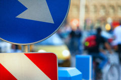 Traffic signs on the street background on a summer day Stock Images
