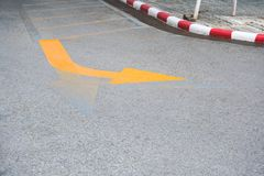 Traffic Signs ,yellow arrow Turning right road sign on the road floor royalty free stock photography