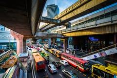 Traffic and skytrain tracks at Siam, in Bangkok, Thailand. Stock Photo
