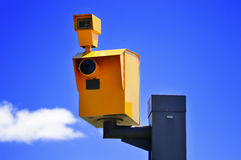 Traffic speed camera over the blue sky Stock Photos