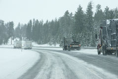 Traffic speeds along icy and snowy roads Stock Image