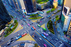 Traffic speeds through an intersection in Gangnam. Royalty Free Stock Images