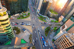 Traffic speeds through an intersection in Gangnam. Stock Images